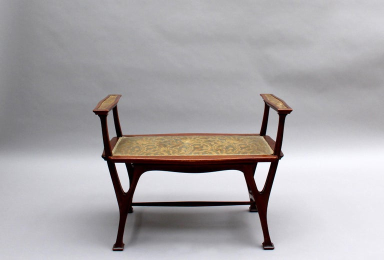 A fine French Art Nouveau upholstered mahogany bench.