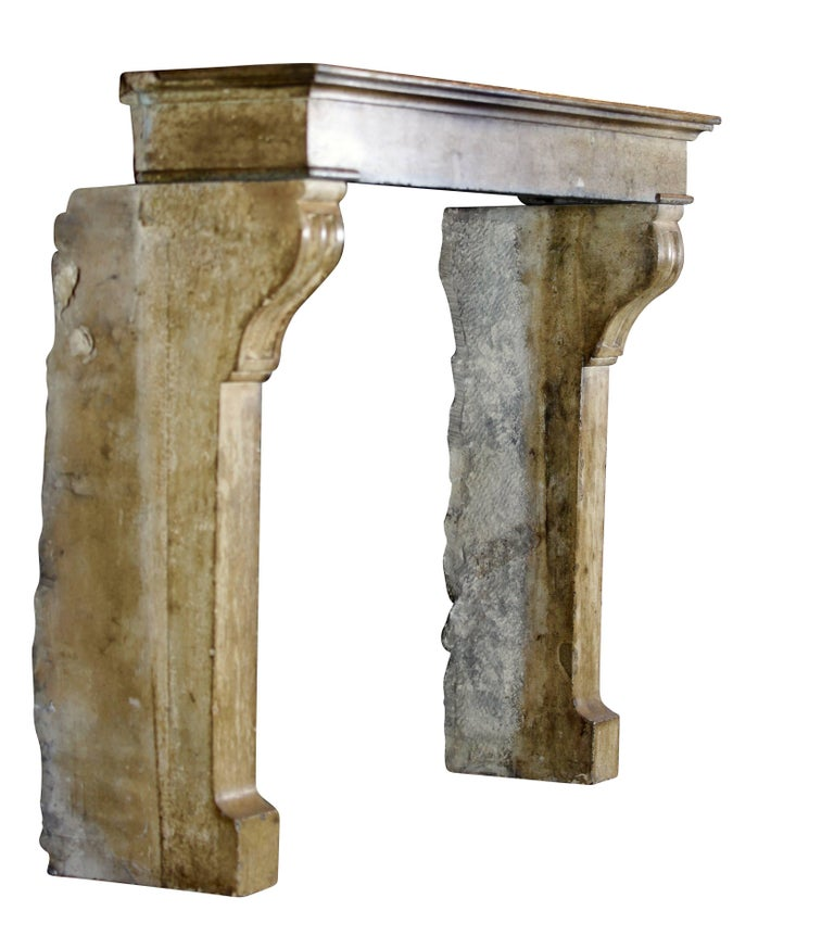 Beautiful antique fireplace mantel (fireplace) with a nice patina, elegant details and in perfect condition. It is a very warm, deep honey colored stone which reflects the light in the room.