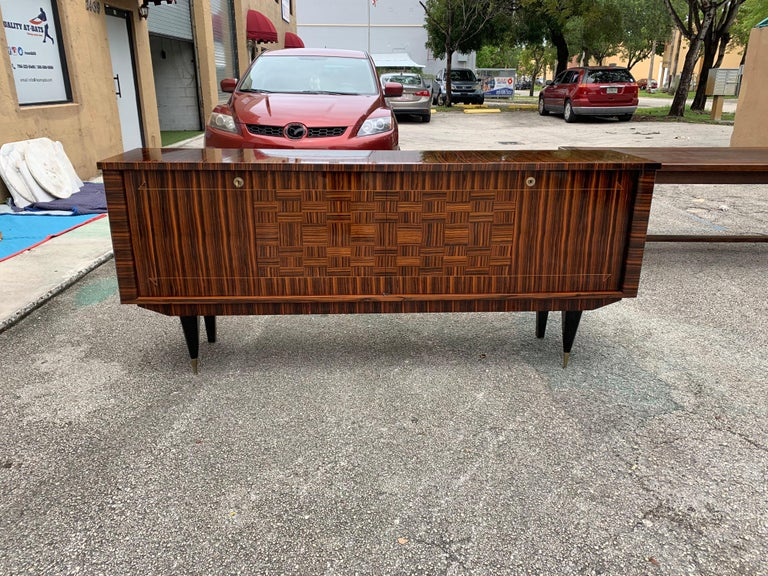 Fine French exotic Macassar ebony sideboard / buffet, circa 1940s. The sideboard are in very good condition ,with 3 shelves adjustable, and 2 drawers ,you can remove all the shelves if you need more space, beautiful bronze hardware detail. Please