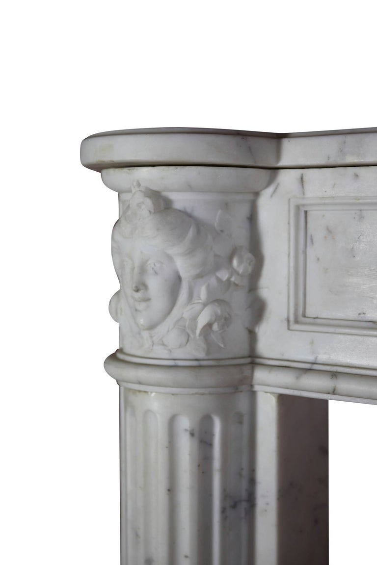 This is a bespoke original antique French fireplace mantel (fireplace) in white statuary marble from the Louis XVI period, 18th century. Exquisite carving. It is still in great condition and ready to be installed. A vintage mantlepiece in a museum