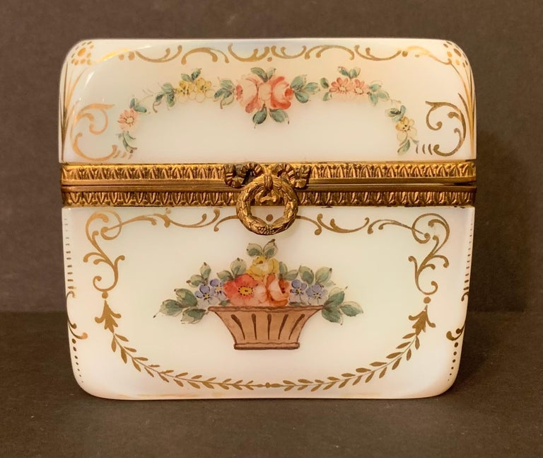 A wonderful French white opaline glass with ormolu bronze mounts and hand painting on all sides as well as the top, jewelry / vanity box.