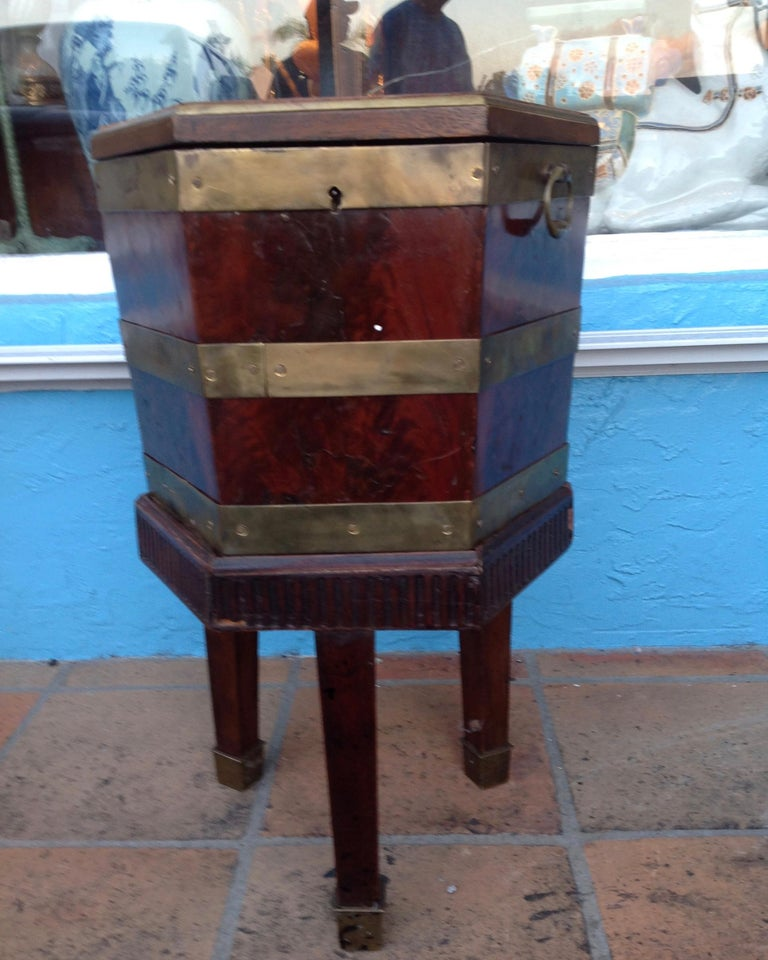 Fitted with its original copper liner and mounted on a mahogany base with a reeded apron. Nice six sided form.