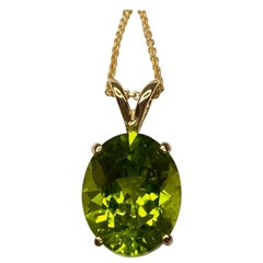Fine Green Peridot 4.11 Carat Oval Cut Yellow Gold Solitaire Pendant Necklace