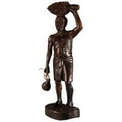 Fine Hardwood Sculpture of Bearded African Man Carrying a Kalabas