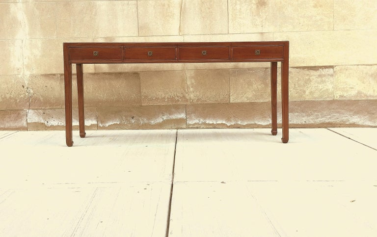 Fine Jumu console table with four drawers. Very elegant and fine quality. Beautiful color and simple form. We carry fine quality furniture with elegant finished and has been appeared many times in