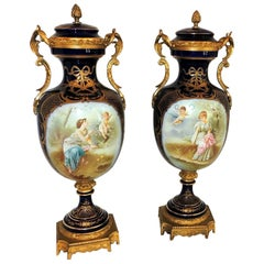 Fine Large Pair French Sevres Cobalt Blue Hand Painted Rimel Bronze Covered Urns