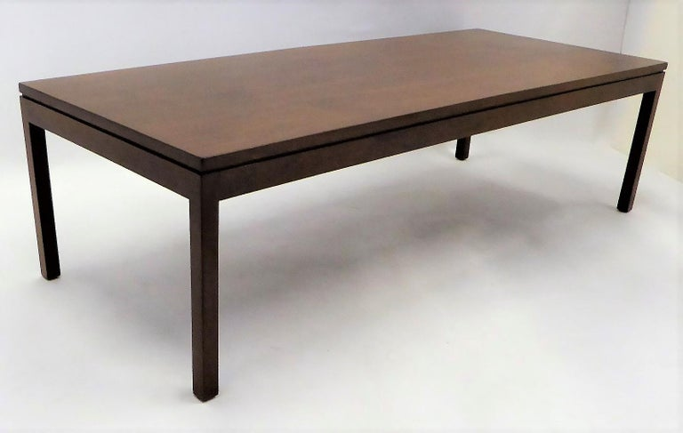 Wonderfully figured Walnut highlights this 1960s long rectangular coffee or Cocktail Table created by Camilo Furniture in Miami. Beautifully restored finish. Parson style, long, it serves as a great sofa table and has a very usable footprint in