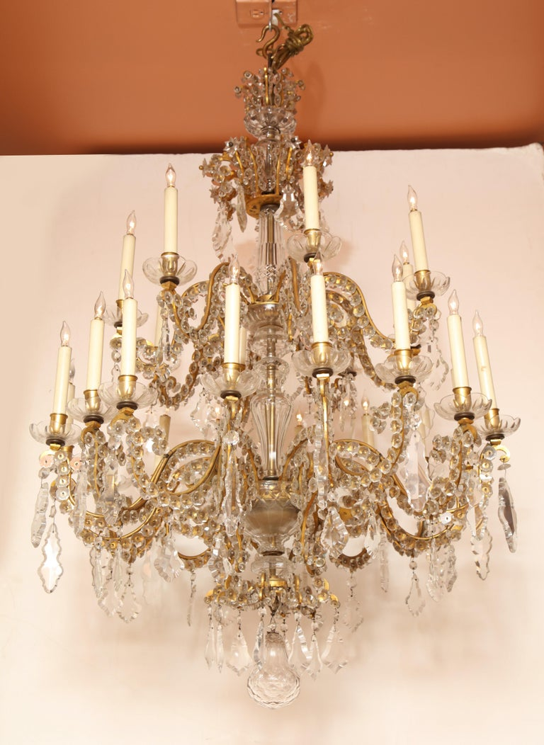 Fine Louis XV crystal and bronze 24-light two-tier chandelier, mid-19th century.