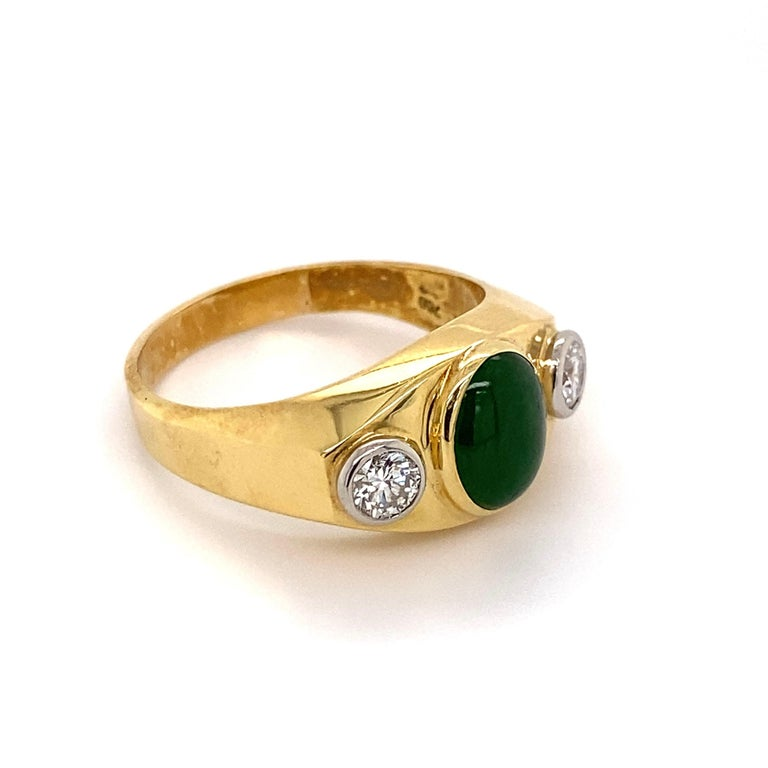 Handsome Gent's Three-Stone Jade and Diamond Gold Signet Ring, centering a securely Hand set 1 Carat Jade, flanked by Diamonds, approx. 0.70tcw, set in 18K White Gold Bezel settings. Hand crafted High Quality 2-tone 18 Karat Yellow and White Gold