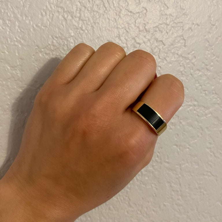Classic and Sleek Gent's 14K Gold Onyx Dome Bar Ring, securely inset with an Onyx. Hand crafted in 14 Karat yellow Gold. Measuring approx. 0.88