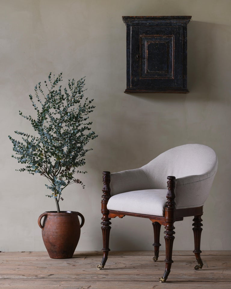 Elegant & fine mid 19th century Neoclassical solid mahogany armchair / desk chair with turned front and back legs on casters, ca 1850 Denmark.