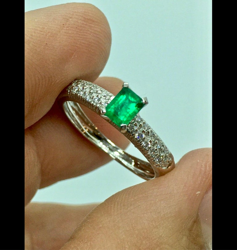 A Fine Natural Colombian Emerald Pave Diamond Engagement Ring 18K White Gold Center High Quality Natural Colombian Emerald, Emerald Cut 0.50 Carat , Vivid Medium intense Green Side Natural Micro pave set Diamonds 0.40 Carat, Clarity VS, Color