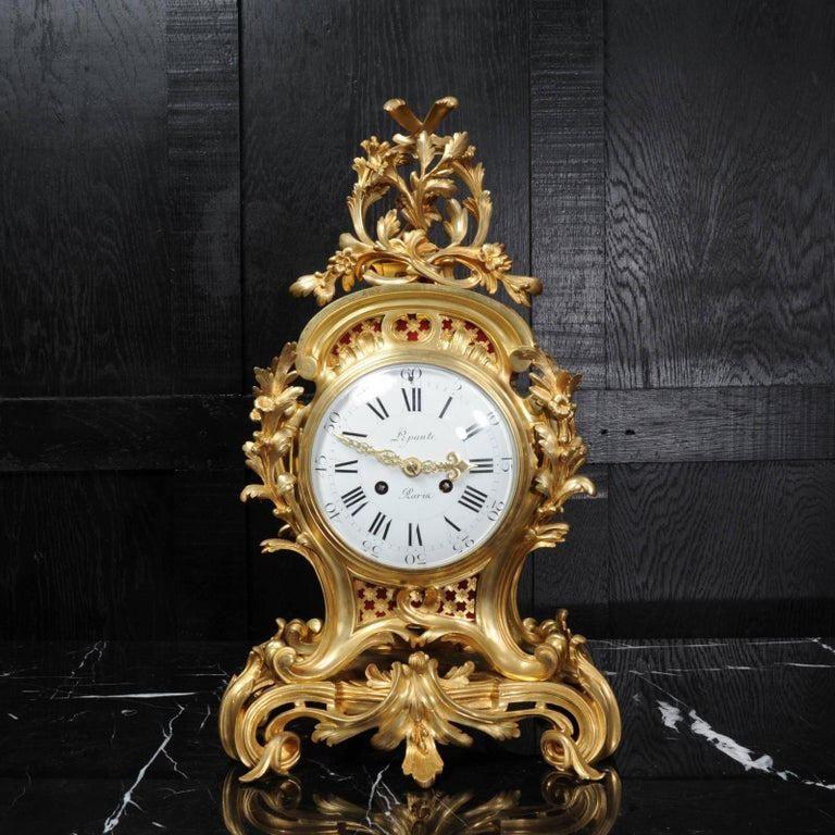 A large and very fine quality ormolu Rococo clock by Henry Lepaute of Paris, part of the illustrious Lepaute clockmaking dynesty. Formed in finely gilded bronze, sinuous scrolls and curves form the case with delicately modeled floral and foliate