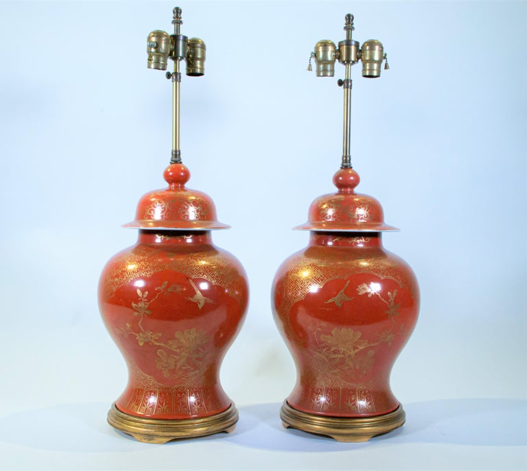 A Pair of Antique 19th Century Chinese Export Orange Ground and 24K Gilt Decorated Vases later turned to Lamps. This is a truly beautiful pair of lamps. The orange color is rarely seen in Chinese porcelain and to further enhance the vibrancy of