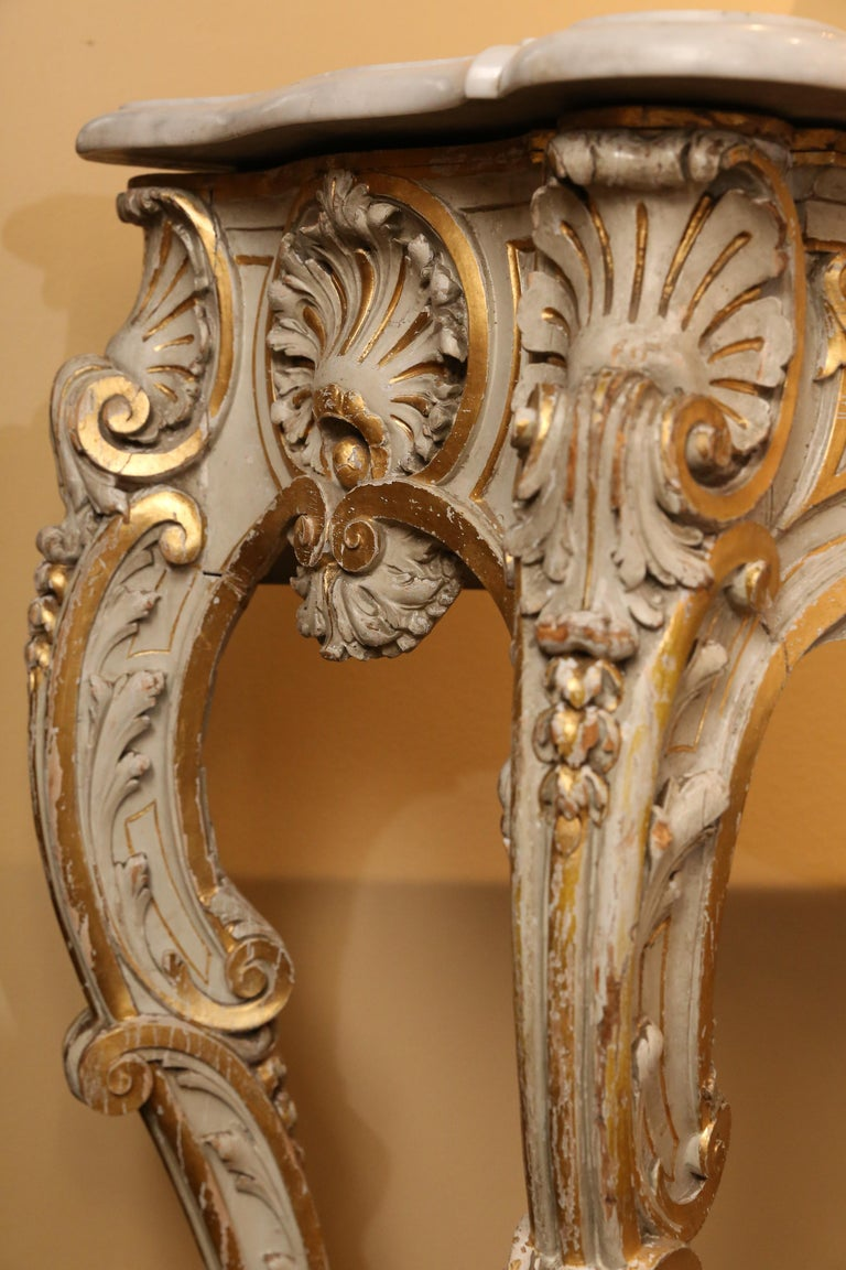 Wood Pair of French Carved Louis XV Consoles, Marble Tops, Parcel Paint/Gilt Finish For Sale