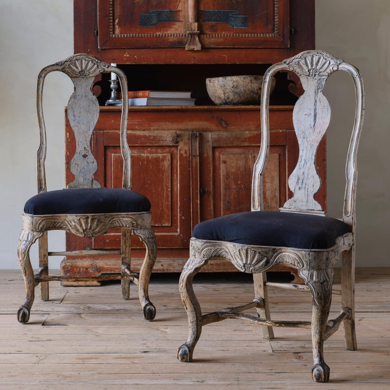 Fine pair of 18th century Swedish Rococo chairs in their original finish and rich in detailed carvings throughout. Ca 1760 Sweden.