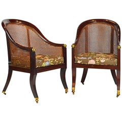 Fine Pair of 19th Century British Colonial Mahogany Barrel Back Cane Chairs