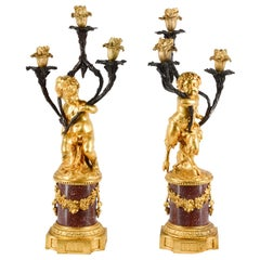 Fine Pair of 19th Century Cherub Candelabra on Porphyry Bases