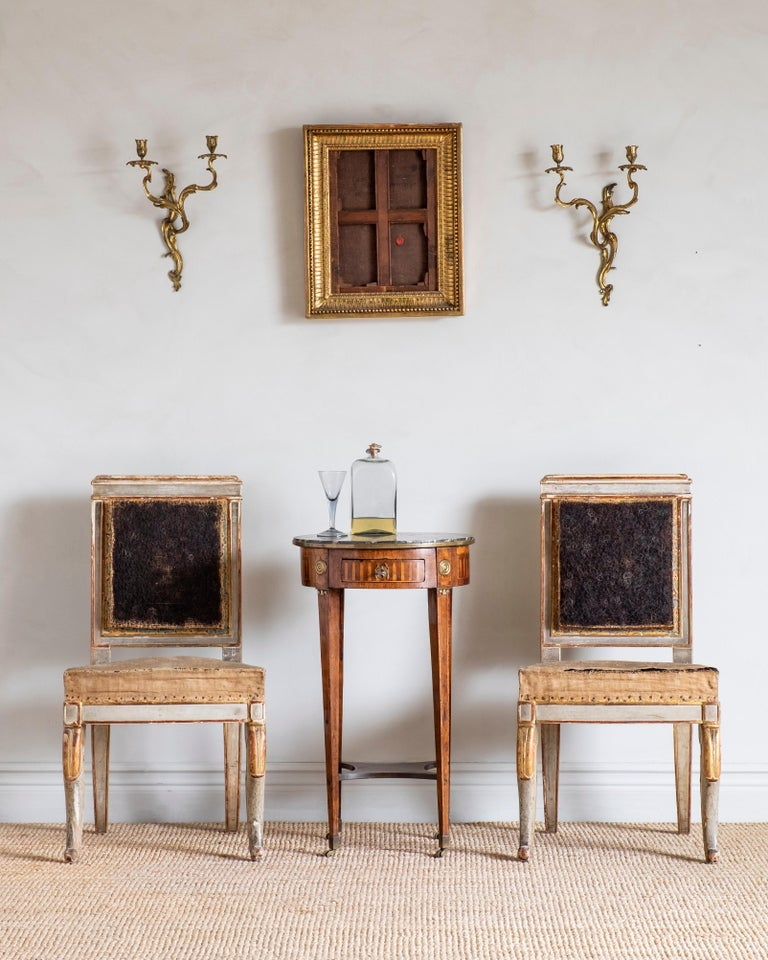 Fine pair of early 19th century Empire side chairs in their original condition, circa 1815, France.   Good original condition with wear consistent with age and use. Structurally good and sturdy. A detailed condition report is available on request.