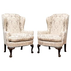 Fine Pair of Antique Carved Wing Chairs