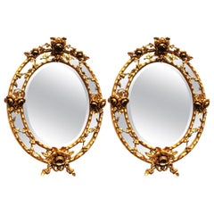 Fine Pair of French Belle Époque Giltwood and Gesso Carved Oval Mirror Frames