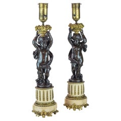 Fine Pair of French Patinated Bronze and Gilt Metal Figural Lamps