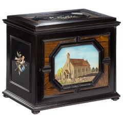 Fine Quality Ebony Bijouterie Table Cabinet Showing Cavalry Church, Stonington