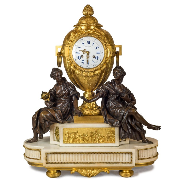 A fine quality French ormolu and patinated bronze and white marble clock set with cherubs holding the candelabras and large central clock with two female figures one holding a globe and the other a scroll. Clock face marked 'De La Fontaine