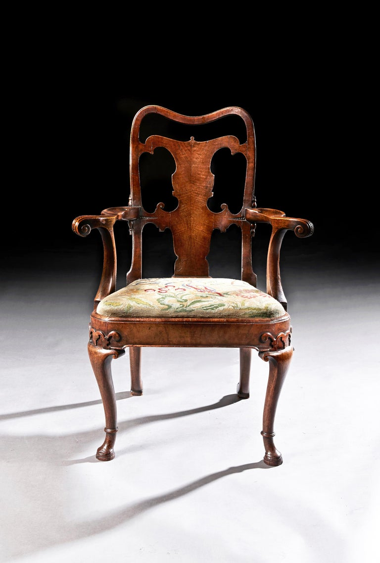 A very fine quality mid-19th century walnut open armchair,