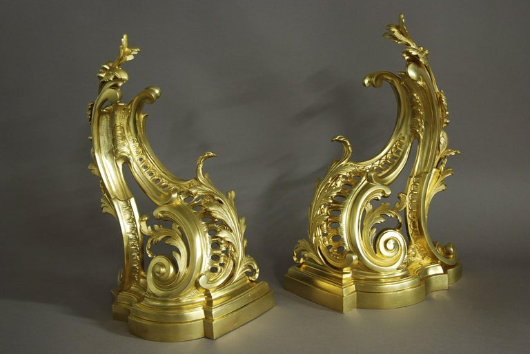 A fine quality pair of late 19th century French Rococo style ormolu chenets (or fire dogs).