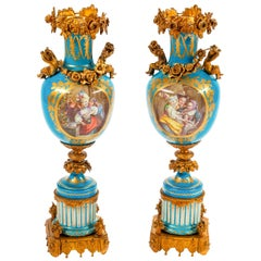 Fine Quality Pair of Sèvres Style Ormolu-Mounted Porcelain Urns with Cherubs