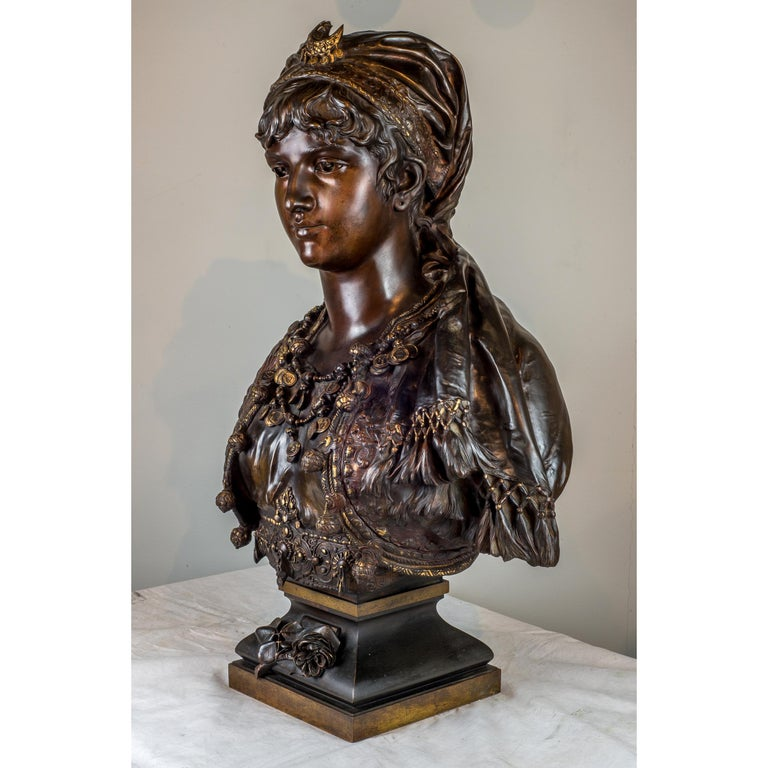 A fine quality polychrome-patinated bronze bust of a gypsy woman. Cast from a model by Adrien-Etienne Gaudez. Signed 'A Gaudez'.  Artist: Adrien-Etienne Gaudez (French, 1845-1902)  Date: 19th century Dimension: 30 in. x 21 1/2 in. x 12 1/2.