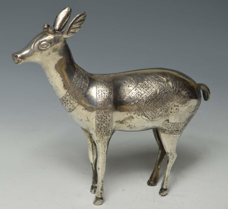 Fine rare Persian Qajar silver deer figure Islamic art A finely made silver model of a deer with engraved designs in high grade silver Period: Persian 19th century  Size height 16 cm 6 inches, length 18 cm, 7 inches , weight 360 grams condition :