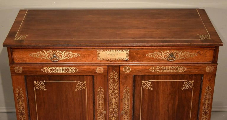Fine Regency period rosewood brass inlaid side cabinet by Pitcher. This piece is illustrated in Markey L& N furniture by C Gilbert page 372 W M Picher London.  Dimensions: Height 34