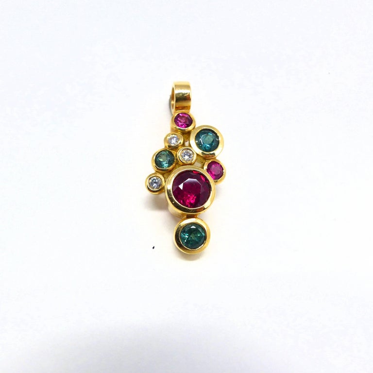 Thomas Leyser is renowned for his contemporary jewellery designs utilizing fine coloured gemstones and diamonds.   This pendant in 18k rose gold is set with 6x fine Tourmalines & Rubelites (facetted, round, 3-6mm, 1.74ct). and 3x Diamonds