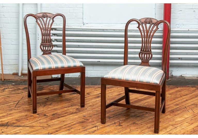 Very well made and fine quality set of ten side chairs with urn form open backs with shaped tops, straight front legs and cross-stretchers. The chairs are solid mahogany having good weight with corner blocking and hand-finished having a particularly