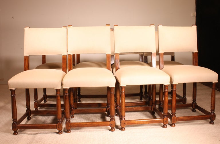 Beautiful set of 8 walnut chairs Louis XIII style 20th century  This beautiful set of French chairs in walnut are in perfect condition.   The chairs were checked, re-polished and upholstered with a velveteen from Italy.  The chairs are very