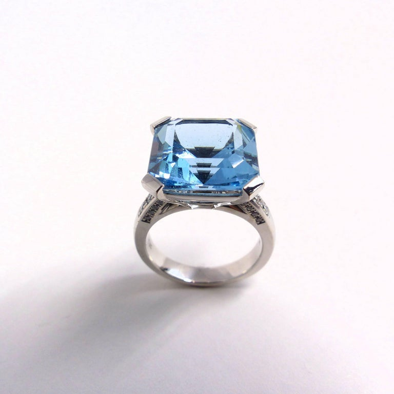 Thomas Leyser is renowned for his contemporary jewellery designs utilizing fine coloured gemstones and diamonds.   This ring in 18k white gold is set with a top quality Aquamarine in assher cut (facetted 12.8 mm - 7.70ct) and brilliant cut diamonds