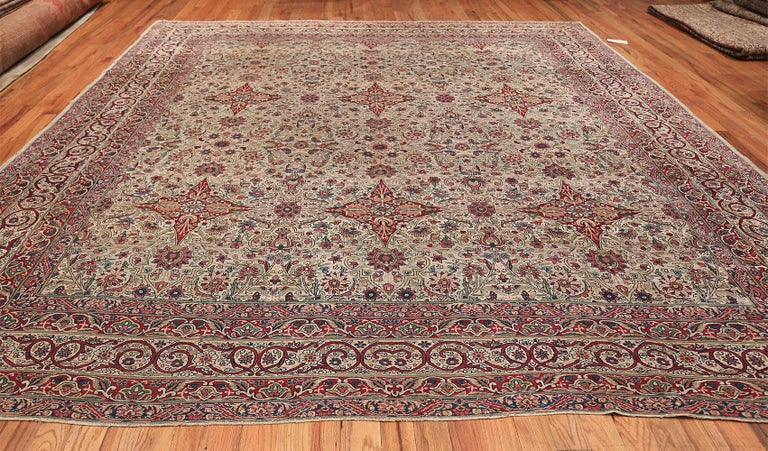 Finely woven square size antique Persian Kerman Lavar rug, Country of Origin: Persia, circa early 20th century. Size: 11 ft x 12 ft (3.35 m x 3.66 m)  To behold this rug is both breathtaking and spectacular. Woven with such attention to detail for