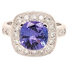 Fine Tanzanite and Diamond 3.90 Carat 14 Karat Ladies Ring Certified