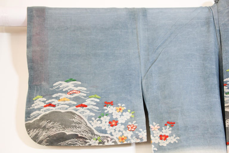 This vintage summer weight or lightweight blue raw silk Japanese Kimono is embroidered with gold thread, red, green and pink details. A fine Japanese Kuro Tomesode Kimono. Hand painted and hand sewn in Japan, circa 1950s. Total width