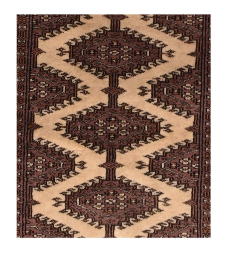 Fine vintage Pak Bokhara rug, hand knotted, circa 1950s  Design: Tribal  A Pakistani rug (Pak Persian rug or Pakistani carpet) is a type of handmade floor-covering textile traditionally made in Pakistan.  Bokhara Ghiordes (Turkish) knot,