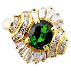 Fine Vintage Tsavorite and Baguette Diamond Cluster Ring in 18 Karat Yellow Gold