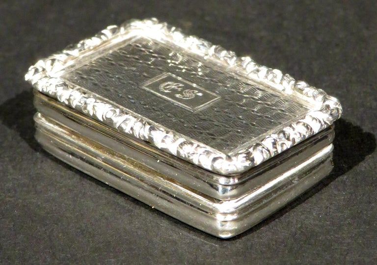 Joseph Willmore is regarded as a one of the finest small-works silversmiths of the 19th century, known primarily as a vinaigrette specialist. The lid and underside showing a fine engine turned surface, the hinged lid decorated with a foliate cast
