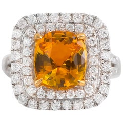 Fine Yellow 4.50 Carat Sapphire Ring with 1.10 Carat of Diamonds