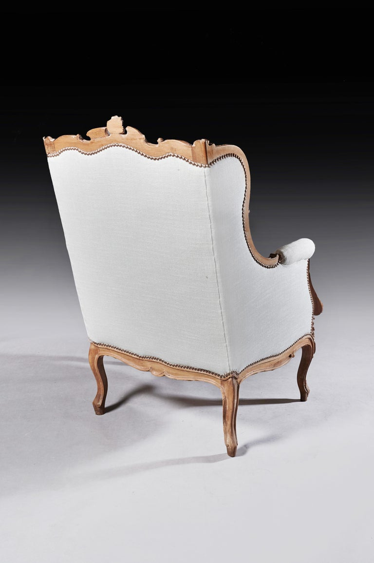 Linen Finely Carved 19th Century French Louis XV Style Wing Armchair For Sale