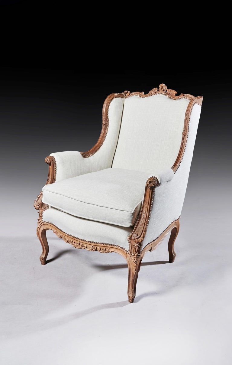 Finely Carved 19th Century French Louis XV Style Wing Armchair For Sale 1