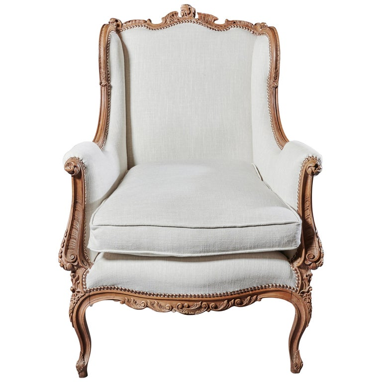 Finely Carved 19th Century French Louis XV Style Wing Armchair For Sale