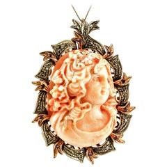Finely Carved Coral, Rubies, Diamonds, 9 Karat Gold and Silver Pendant or Brooch