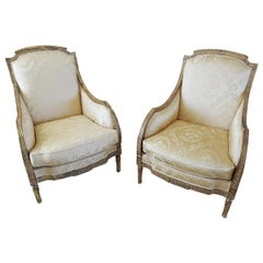 Finely Carved Gilded and Painted Pair of French Louis XVI Bergere Chairs